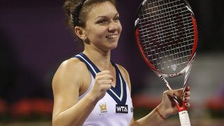 Simona Halep of Romania celebrates defeating Sara Errani of Italy in their women's singles quarter-final match at the Qatar Open tennis tournament in Doha February 14, 2014. REUTERS/Fadi Al-Assaad (QATAR - Tags: SPORT TENNIS)