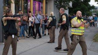 MUNICH, GERMANY - JULY 22: Police escort people that were in the mall during the shooting in Munich, Germany on July 22, 2016. Several people have been killed on Friday after an unknown number of assailants opened fire in a shopping mall in the southern German city of Munich. Sebastian Widmann / Anadolu Agency